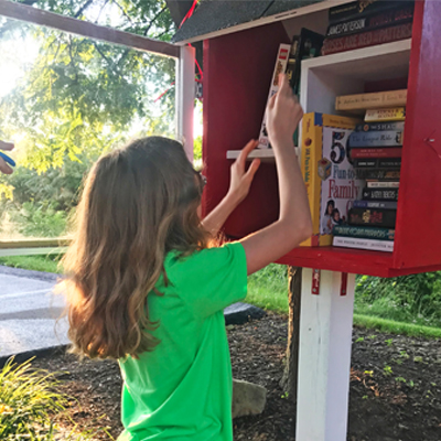 Young philanthropist opens little free library
